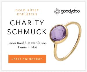 gold küsst edelstein ring